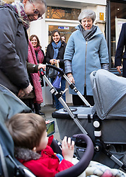 © Licensed to London News Pictures. 04/03/2019. Salisbury, UK. A child in a pram waves at Prime Minister Theresa May during a visit to Salisbury on the first anniversary of the poisoning of former Russian spy Sergei Skripal and his daughter Yulia in March 2018. They both survived the nerve agent attack but a resident of nearby Amesbury, Dawn Sturgess, died in June 2018 after coming in contact with the poison. Two Russians have been named in connection with the attack. Photo credit: Peter Macdiarmid/LNP