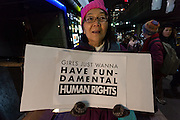 A Japanese woman at a protest march by members of the Democratic Party Abroad organisation to mark the inauguration of President Donald Trump, Tokyo, Japan. Friday January 20th 2017 Around 400 people took apart in the march, which started in Hibiya Park at 6:30pm and finished in Roppongi just before 8pm, to honour the service given by President Obama and to protest against the illiberal policies expected of the new administration of President  Trump.