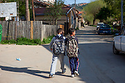Two boys which are friends getting home from school - in the city of Crnik.