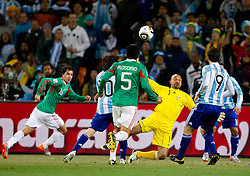 Lionel Messi of Argentina vs goalkeeper of Mexico Oscar Perez during the 2010 FIFA World Cup South Africa Round of Sixteen match between Argentina and Mexico at Soccer City Stadium on June 27, 2010 in Johannesburg, South Africa. (Photo by Vid Ponikvar / Sportida)