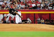 Jun. 18 2011; Phoenix, AZ, USA; Arizona Diamondbacks base runner Chris Young (24) runs the bases while playing against the Chicago White Sox at Chase Field. The White Sox defeated the Diamondbacks 6-2. Mandatory Credit: Jennifer Stewart-US PRESSWIRE.