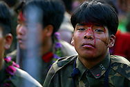 A young soldier from the second battalion already marked by injuries of war listens to speakers during a cultural program and remembrance ceremony in the village of Kholagaun, in the Maoist heartland of Nepal Thursday April 22, 2004.  In the mountains of Nepal, one of the world's last full-blown Maoist revolutions is thriving/forging ahead/gaining ground. The doctrines of Mao, the Chinese communist leader who believed in communism via an empowered peasantry, have found new life in the farm fields of this Himalayan kingdom. The rebels contend their revolution _ which has cost more than 9,500 lives _ is only possible through the barrel of a gun.