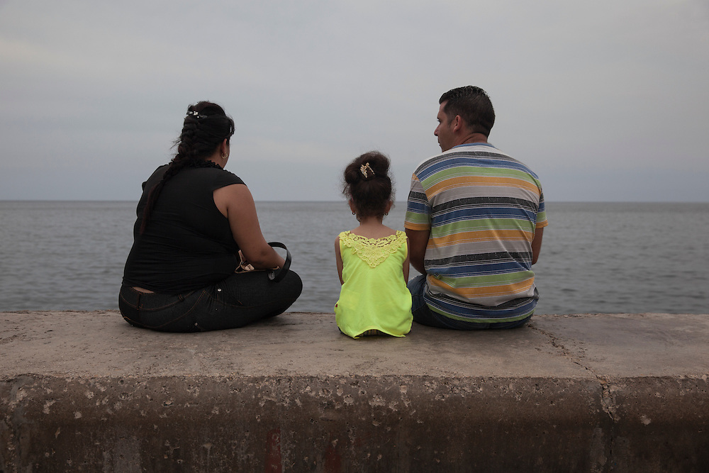 A family enjoys the afternoon at the Malecon in Havana, Cuba.