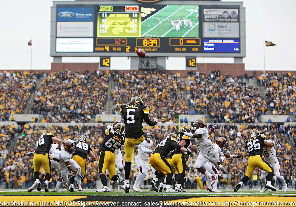 November 21, 2009: Iowa punter Ryan Donahue (5) punts the ball during the second half of the Iowa Hawkeyes 12-0 win over the Minnesota Golden Gophers at Kinnick Stadium in Iowa City, Iowa on November 21, 2009.