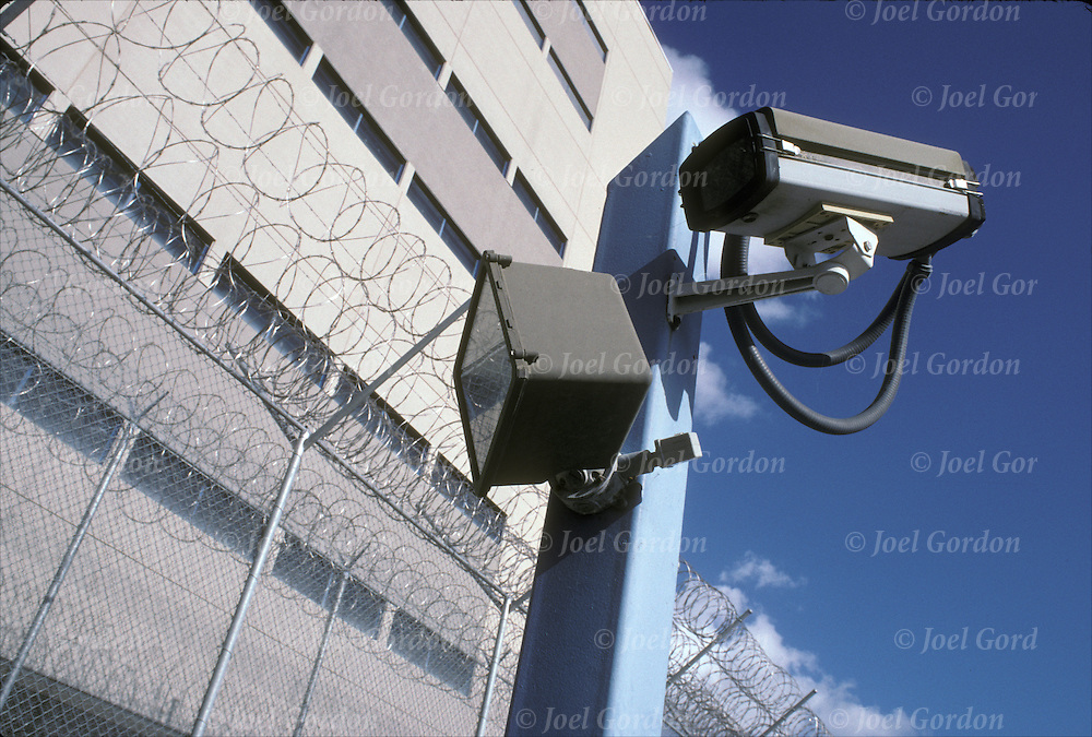 Security camera and razor sharp wire perimeter fence of Orange County jail. The Horizon Facility is a state-of-the art direct supervision jail holding 1,250 inmates.