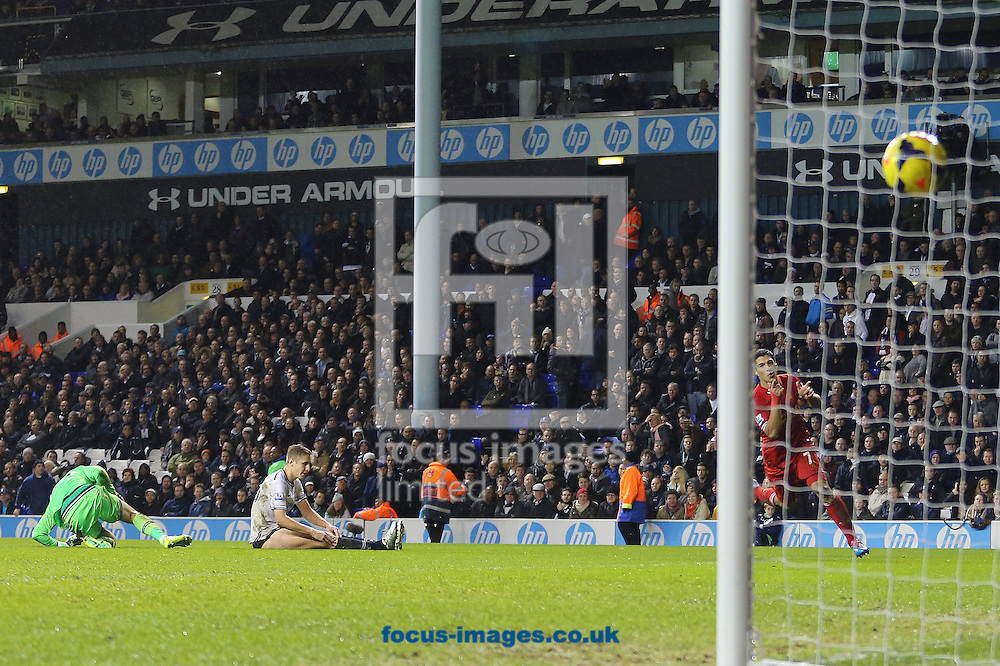 Picture by Richard Calver/Focus Images Ltd +447792 981244<br /> 15/12/2013<br /> Luis Suarez of Liverpool scores to make it 4-0 during the Barclays Premier League match against Tottenham Hotspur at White Hart Lane, London.