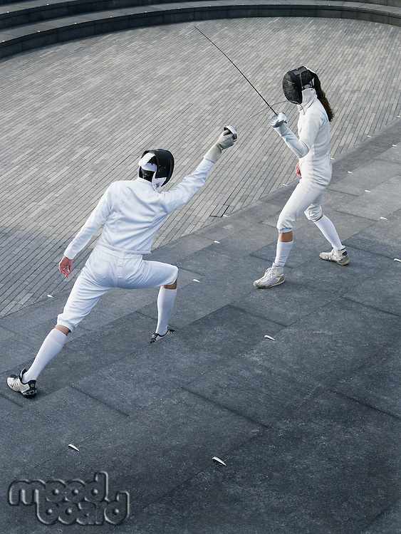 Two athletes fencing on steps of the Scoop amphitheatre London England elevated view