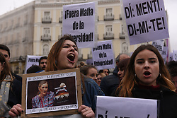 April 12, 2018 - Madrid, Madrid, Spain - Students hold banners and shout slogans as they take part in a protest in Madrid to demand the resignation of Madrid's regional president Cristina Cifuentes, who is accused of falsified a masters degree from the public Rey Juan Carlos University. (Credit Image: © Jorge Sanz/Pacific Press via ZUMA Wire)
