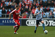 Coventry City forward Darius Henderson (44)  takes on Swindon Town defender Jamie Sendles-White (21)    during the Sky Bet League 1 match between Coventry City and Swindon Town at the Ricoh Arena, Coventry, England on 19 March 2016. Photo by Simon Davies.