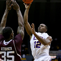 Jan 23, 2013; Baton Rouge, LA, USA; LSU Tigers guard Anthony Hickey (12) shoots over Texas A&M Aggies forward Ray Turner (35) during the second half of a game at the Pete Maravich Assembly Center. LSU defeated Texas A&M 58-54. Mandatory Credit: Derick E. Hingle-USA TODAY Sports