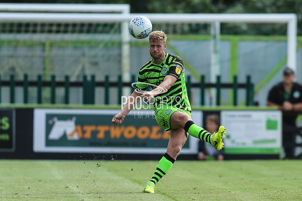 Forest Green Rovers Matt Mills(5) passes the ball forward during the EFL Sky Bet League 2 match between Forest Green Rovers and Grimsby Town FC at the New Lawn, Forest Green, United Kingdom on 17 August 2019.