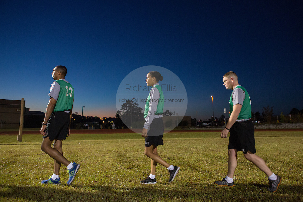 Male and female Drill Sergeant candidates at the US Army Drill Instructors School Fort Jackson take their entry physical training test early morning September 27, 2013 in Columbia, SC. While 14 percent of the Army is women soldiers there is a shortage of female Drill Sergeants.