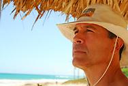 Yours truly (German Silva, professional wedding and special event photographer) at the beach.  Streets, beach, details of Havana, Cuba.  <br /> <br /> Quien les habla, en la playa.  La calle, la playa, detalles de La Habana Vieja, Cuba.  La Habana Vieja &ndash; Old Havana, Cuba.   <br /> <br /> Photo Copyrighted 2014 by German Silva.  All rights reserved.