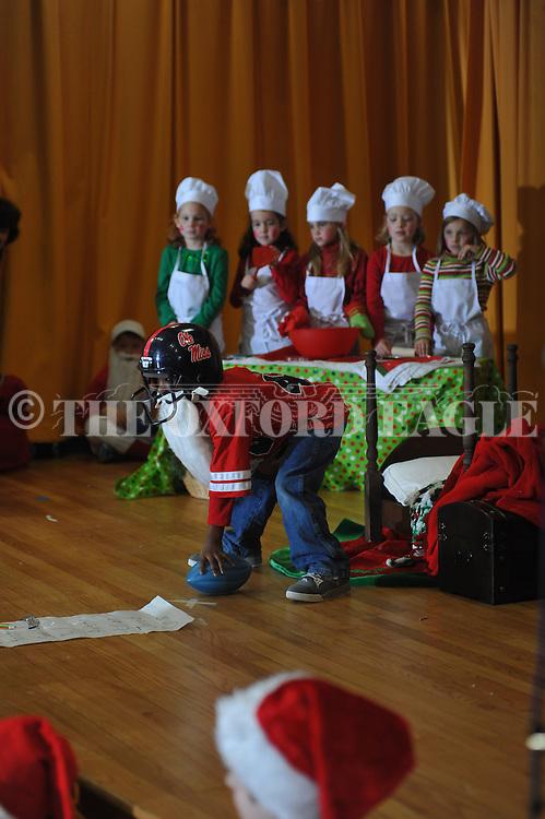 "A'lijah Burt is Football Santa during the Bramlett Elementary play ""That's Not Santa"" in Oxford, Miss. on Wednesday, December 19, 2012."