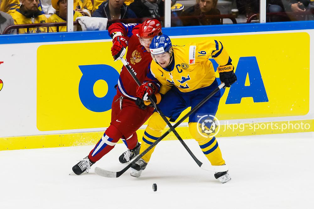 140104 Ishockey, JVM, Semifinal,  Sverige - Ryssland<br /> Icehockey, Junior World Cup, SF, Sweden - Russia.<br /> Nikita Tryamkin, (RUS), Filip Forsberg, (SWE).<br /> Endast f&ouml;r redaktionellt bruk.<br /> Editorial use only.<br /> &copy; Daniel Malmberg/Jkpg sports photo