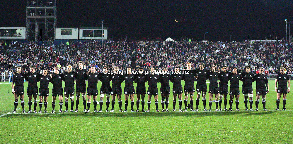 The All Blacks line up for the national anthem during the All Blacks v Fiji Test match played at Albany Stadium, New Zealand, on Friday 10 June, 2005. The All Blacks won the match 91-0. Photo: Andrew Cornaga/PHOTOSPORT<br /><br /><br />126862
