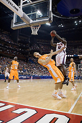 Virginia Cavaliers guard/forward Solomon Tat (45) shoots as Tennessee Volunteers forward Ryan Childress (34) dives to the court.  The #4 seed Virginia Cavaliers were defeated by the #5 seed Tennessee Volunteers 77-74 in the second round of the Men's NCAA Tournament in Columbus, OH on March 18, 2007.