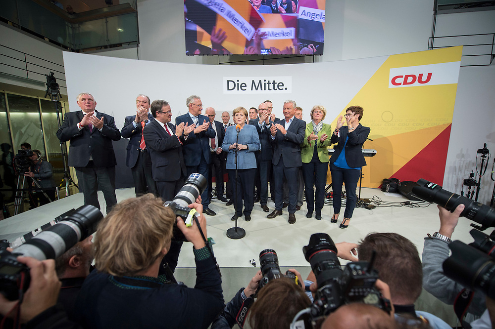 24 SEP 2017, BERLIN/GERMANY:<br /> Angela Merkel (M), CDU, Bundeskanzlerin, tritt ein zweites mal ans Mikrofon, eingerahmt von Karl-Josef Laumann, Philipp Murmann, Armin Laschet, Joachim Herrmann, Volker Kauder, Klaus Schueler, Thomas de Maiziere, David McAllister, Peter Tauber, Jens Spahn, Thomas Strobl, Elmar Brok, Monika Gruetters, Annegret Kramp-Karrenbauer, (v.L.n.R.), Wahlparty in der Wahlnacht, Bundestagswahl 2017, Konrad-Adenauer-Haus, CDU Bundesgeschaeftsstelle<br /> IMAGE: 20170924-01-068<br /> KEYWORDS: Election Party, Election Night