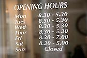 Shop opening hours on glass door