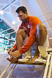 07.06.2011, Stanglwirt, Going, AUT, Wladimir Klitschko, Training, im Bild Wladimir Klitschko umwickelt seien Zehen mit Tapeduring a training session at Hotel Stanglwirt, Going, Austria on 7/6/2011. EXPA Pictures © 2011, PhotoCredit: EXPA/ J. Groder