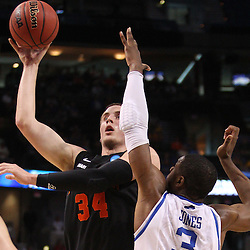 Mar 17, 2011; Tampa, FL, USA; Princeton Tigers forward Ian Hummer (34) shoots over Kentucky Wildcats forward Terrence Jones (3) during second half of the second round of the 2011 NCAA men's basketball tournament at the St. Pete Times Forum. Kentucky defeated Princeton 59-57.  Mandatory Credit: Derick E. Hingle