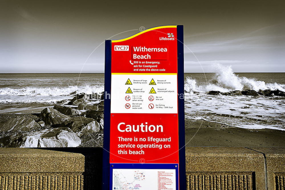 Winter on Withernsea seafront, warning information sign by East Riding Council