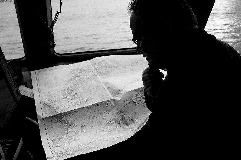 Captain Svein Ivar Vinnes studying the map..Photo by Knut Egil Wang /MOMENT