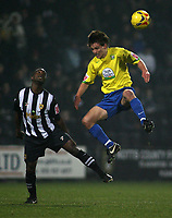 Photo: Paul Thomas.<br /> Notts County v Hereford United. Coca Cola League 2. 22/12/2006.<br /> <br /> Luke Webb (Yellow) of Hereford ewins the ball from Jay Smith.
