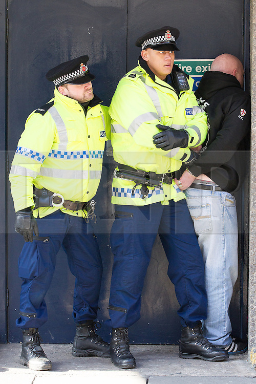 © Licensed to London News Pictures . 02/03/2013 . Manchester , UK . Police detain a member of the EDL crowd . The English Defence League hold a march and demonstration in Manchester City Centre . Photo credit : Joel Goodman/LNP
