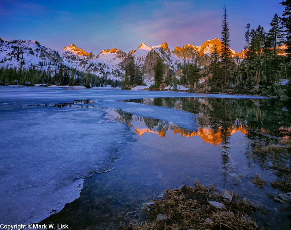 Ice thaws from Alice Lake on warm spring days in the Sawtooth Wilderness Area, Idaho.