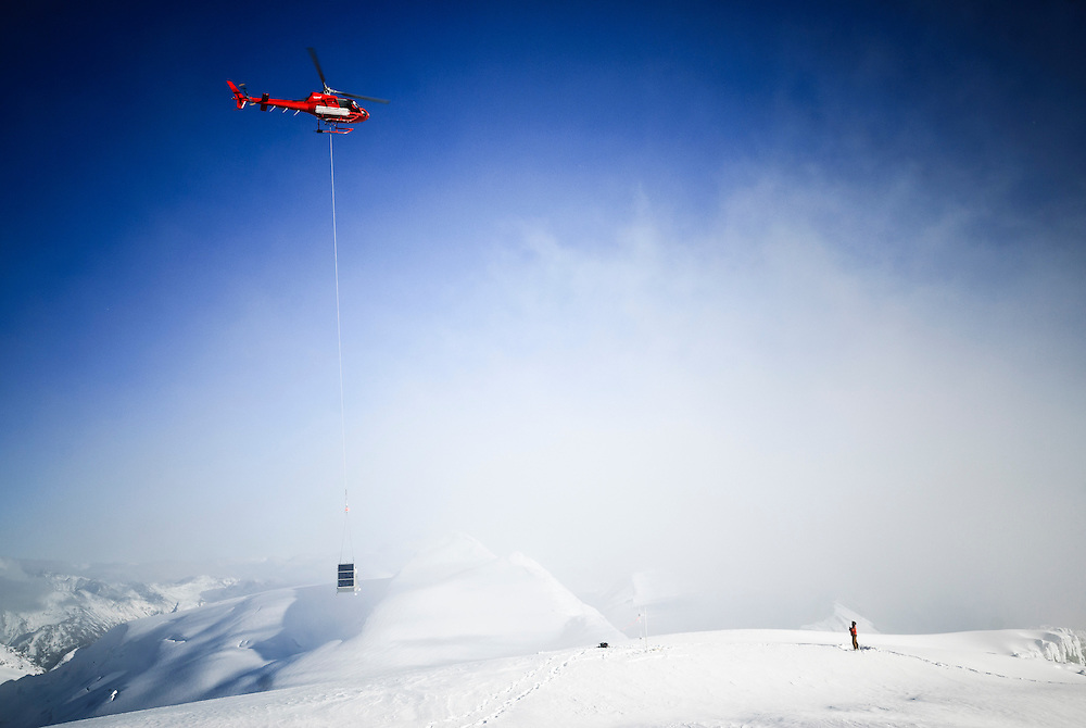 An A-Star helicopter delivers a radio repeater during a late fall drilling campaign in southwest British Columbia