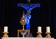 A monstrance holding the Blessed Sacrament sits on an altar during adoration at a Catholic men's conference. (Sam Lucero photo)