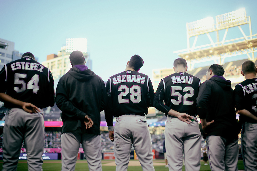 San Diego, CA - JUNE 04:   Nolan Arenado stands in formation with teamates during the singing of the Star Spangled Banner at Petco Park during game with the San Diego Padres San Diego, California.  (Sandy Huffaker for ESPN)