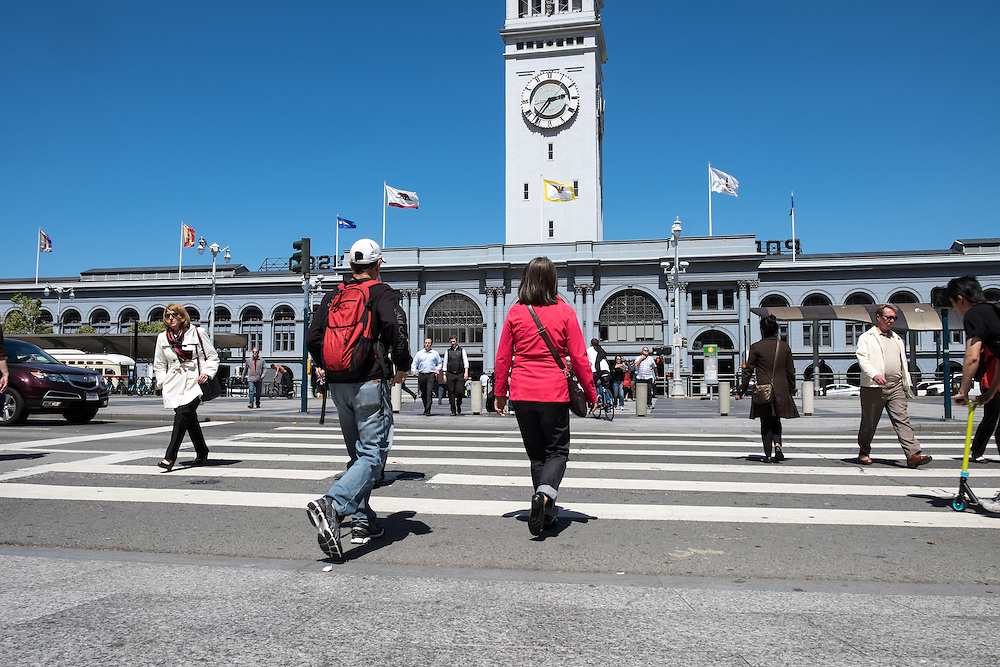 Pedestrians crossing street in front of San Francisco's Ferry Building | May 6, 2014