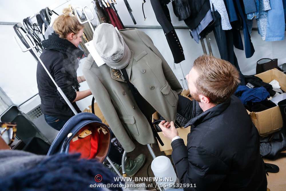 NLD/Amsterdam/20130126 - Modeshow Supertrash 2013, mannequins worden opgemaakt voor de show