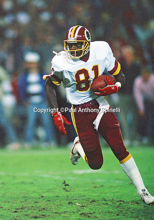 Washington Redskins wide receiver Art Monk (81) runs with the ball after catching a pass during the NFL football game against the New Orleans Saints on Nov. 6, 1988 in Washington, DC. The Redskins won the game 27-24. (©Paul Anthony Spinelli)