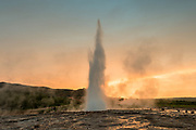 Strokkur is a fountain geyser in the geothermal area beside the Hvítá River in Iceland in the southwest part of the country, east of Reykjavík. It is one of Iceland's most famous geysers, erupting about every 8-10 minutes 15 – 20 m high, sometimes up to 40 m high.