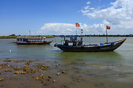 2 Boats on the river front in Hoi An