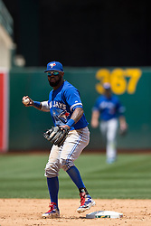 OAKLAND, CA - JULY 23:  Jose Reyes #7 of the Toronto Blue Jays throws to first base to complete a double play against the Oakland Athletics during the sixth inning at O.co Coliseum on July 23, 2015 in Oakland, California. The Toronto Blue Jays defeated the Oakland Athletics 5-2. (Photo by Jason O. Watson/Getty Images) *** Local Caption *** Jose Reyes