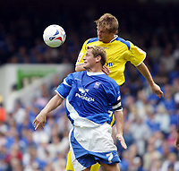 Fotball<br /> Foto: SBI/Digitalsport<br /> NORWAY ONLY<br /> <br /> Ipswich Town v Cardiff City<br /> Coca Cola Championship.<br /> 06/08/2005.<br /> <br /> Neal Ardley of Cardiff heads away from Jim Magilton of Ipswich