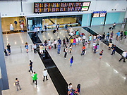 10 AUGUST 2013 - HONG KONG:    People come out of the arrivals hall at Hong Kong International Airport. Hong Kong is one of the two Special Administrative Regions of the People's Republic of China, Macau is the other. It is situated on China's south coast and, enclosed by the Pearl River Delta and South China Sea, it is known for its skyline and deep natural harbour. Hong Kong is one of the most densely populated areas in the world, the  population is 93.6% ethnic Chinese and 6.4% from other groups. The Han Chinese majority originate mainly from the cities of Guangzhou and Taishan in the neighbouring Guangdong province.      PHOTO BY JACK KURTZ