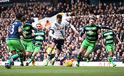 Dele Alli of Tottenham Hotspur takes on the Swansea City defence - Mandatory byline: Robbie Stephenson/JMP - 28/02/2016 - FOOTBALL - White Hart Lane - Tottenham, England - Tottenham Hotspur v Swansea City - Barclays Premier League