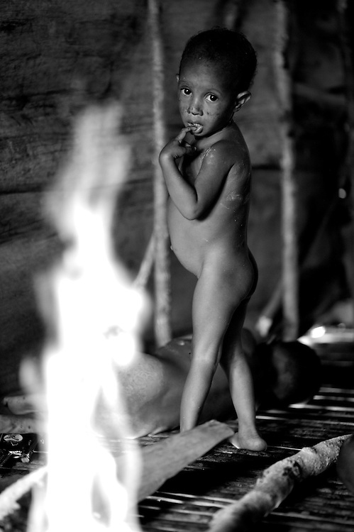 kombai girl at home by the fire