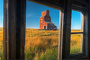 Grain elevator from inside old general store in ghost town<br /> Bents<br /> Saskatchewan<br /> Canada