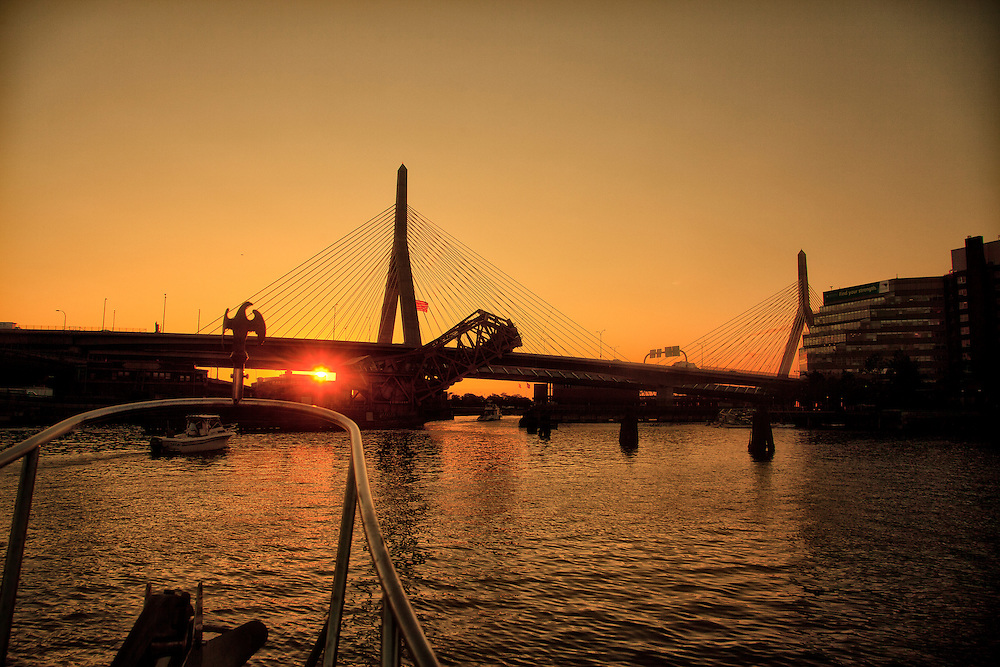 The Kumatage approaching the Arnold Zakem showing the commuter railroad bridge lifting at dawn on the Charles River in Boston and heading to the Charles River Locks.