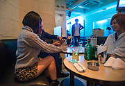 """Host Miu Tsukisaki (right) and writer Gavin Blair entertain a guest at Shangrila host Club in Shinjuku, Tokyo, Japan on Nov. 15, 2016.  In Japan  """"Host"""" refers to young men who work at nightclubs that cater exclusively to women. ROB GILHOOLY PHOTO"""