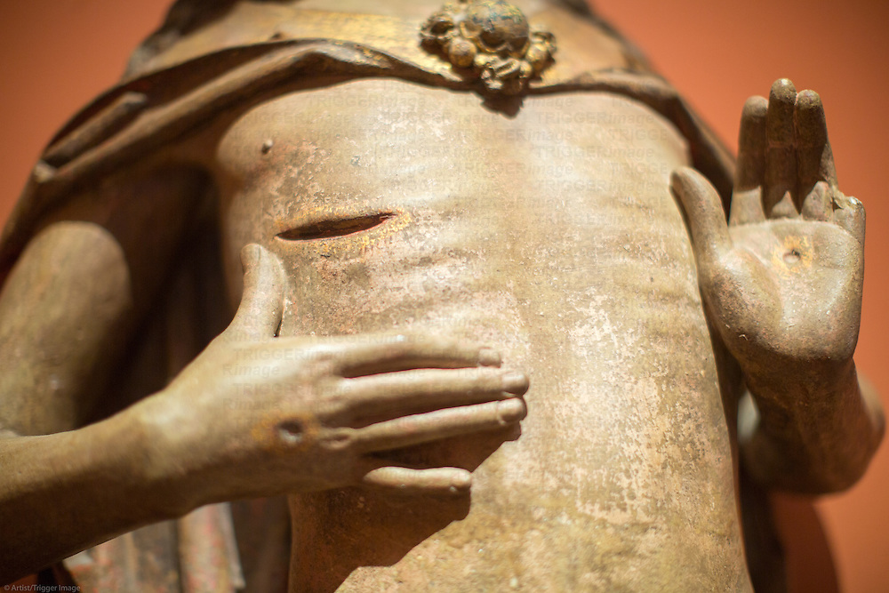 Detail of the wound of a Christ sculpture by Pedro Millan (15th century), Museum of Fine Arts, Seville, Spain