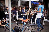 (L-R) Soraya Darabi, 27, Ted Grubb, 30, and Alexa Andrzejewski, 27, wait for their order at Delfina, in the Mission District, in San Francisco, Ca., on Wednesday, May 25, 2011. They are three entreprenuers who developed the iPhone app, Foodspotting.
