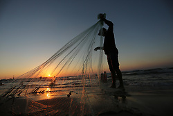 August 4, 2017 - Gaza City, Gaza Strip, Palestinian Territory - A Palestinian fisherman pulls his nets on a beach in Gaza City.  (Credit Image: © Ashraf Amra/APA Images via ZUMA Wire)