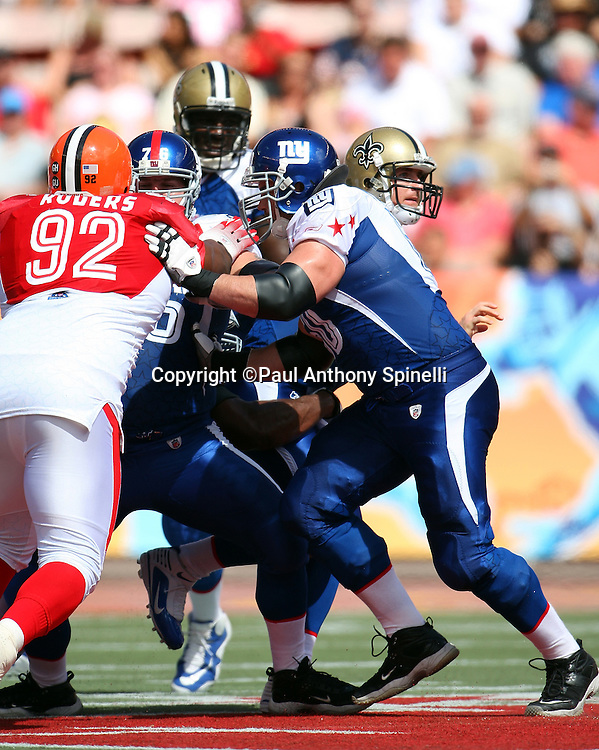 HONOLULU, HI - FEBRUARY 08: NFC All-Stars center Shaun O'Hara #60 of the New York Giants and guard Chris Snee #76 of the Giants double team block AFC All-Stars defensive tackle Shaun Rogers #92 of the Cleveland Browns in the 2009 NFL Pro Bowl at Aloha Stadium on February 8, 2009 in Honolulu, Hawaii. The NFC defeated the AFC 30-21. ©Paul Anthony Spinelli *** Local Caption *** Shaun O'Hara;Chris Snee;Shaun Rogers